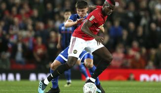 Rochdale's Aaron Morley, left, and Manchester United's Paul Pogba battle for the ball during their English League Cup, Third Round soccer match at Old Trafford, Manchester, England, Wednesday, Sept. 25, 2019. (Richard Sellers/PA via AP)