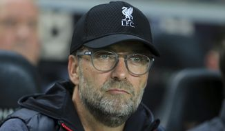 Liverpool's manager Jurgen Klopp watches before the League Cup soccer match between Milton Keynes Dons and Liverpool at the MK Dons Stadium, Milton Keynes England, in London, England, Wednesday, Sept. 25, 2019. (AP Photo/Leila Coker)
