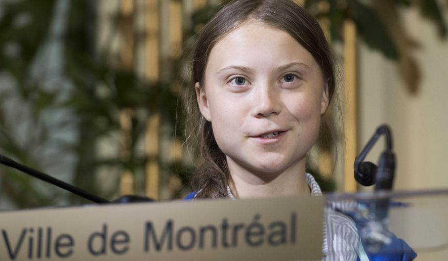 Swedish climate activist Greta Thunberg speaks to reporters after receiving the key to the city of Montreal during a ceremony in Montreal, Friday, Sept. 27, 2019. (Graham Hughes/The Canadian Press via AP)