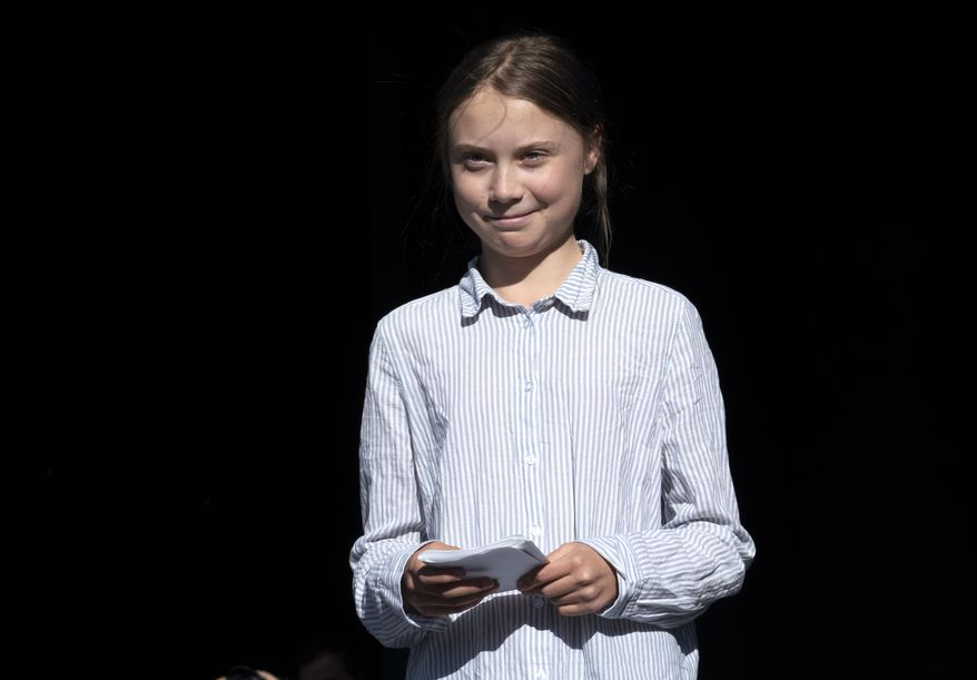 Swedish activist and student Greta Thunberg walks off the stage after addressing the Climate Strike in Montreal, Quebec, Friday, Sept. 27, 2019. (Paul Chiasson/The Canadian Press via AP)