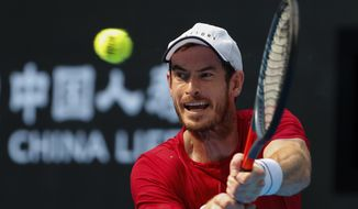 Andy Murray of Britain hits a return shot against his compatriot Cameron Norrie during their second round of the men's singles match in the China Open tennis tournament at the Diamond Court in Beijing, Wednesday, Oct. 2, 2019. (AP Photo/Andy Wong)