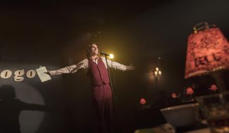 This image released by Warner Bros. Pictures shows Joaquin Phoenix in a scene from 'Joker' in theaters on Oct. 4.  (Niko Tavernise/Warner Bros. Pictures via AP)