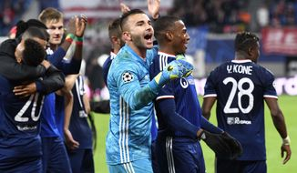 Lyon goalkeeper Anthony Lopes celebrates with team mates after winning the Champions League group G first round soccer match between RB Leipzig and Olympique Lyon, in Leipzig, Germany, Wednesday, Oct. 2, 2019. (AP Photo/Jens Meyer)