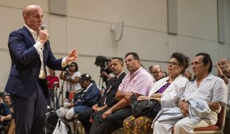 U.S. Rep. Max Rose, left, speaks to constituents during a town hall meeting, Wednesday, Oct. 2, 2019, at the Joan and Alan Bernikow Jewish Community Center in the Staten Island borough of New York. (AP Photo/Mary Altaffer)