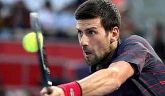 Novak Djokovic of Serbia hits a forehand against Go Soeda of Japan during a second round of Japan Open Tennis Championships in Tokyo, Wednesday, Oct. 2, 2019. (AP Photo/Koji Sasahara)
