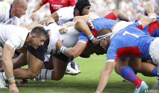 Players of Italy, left, and Namibia scrum during the Rugby World Cup Pool B game between Italy and Namibia in Osaka, western Japan, Sunday, Sept. 22, 2019. (Yohei Fukuyama/Kyodo News via AP)