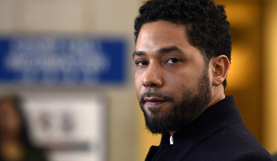 FILE - In this March 26, 2019, file photo, actor Jussie Smollett talks to the media before leaving Cook County Court after his charges were dropped, in Chicago. The latest twist in the Jussie Smollett saga is the revelation of a possible conflict of interest by the special prosecutor investigating why prosecutors dropped charges accusing the actor of staging a racist, homophobic attack on himself. Dan Webb disclosed this week he once co-hosted a political fundraiser for a figure central to his investigation, Cook County State's Attorney Kim Foxx. A Cook County judge must now decide if bias or the appearance of bias renders Webb's position untenable. (AP Photo/Paul Beaty, File)