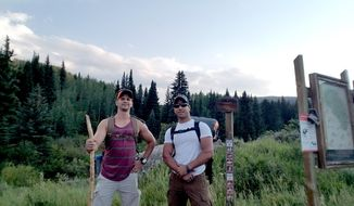 In this July 7, 2017 photo provided by Trevor Reilly shows Trevor Reilly, left, posing with Marine Pfc. Ali Al-kazahg while hiking in the Eagles Nest Wilderness of the Dillon Ranger District in Colorado. Al-kazahg faces a military hearing after the Hawaii-based Marine was apprehended at an Air Force base in Nebraska. Officials say he tried to bring weapons on to the base and made threats. (Trevor Reilly via AP)