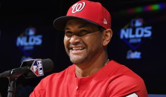 Washington Nationals manager Dave Martinez answers a reporter's question during a news conference prior to practice for Game 1 of the NLDS baseball game against the Los Angeles Dodgers Wednesday, Oct. 2, 2019, in Los Angeles. (AP Photo/Mark J. Terrill) ** FILE **