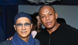 "This Feb. 10, 2013, file photo shows music industry entrepreneur Jimmy Iovine, left, and hip-hop mogul Dr. Dre at a Grammy Party in Los Angeles. A high-tech building named after Andre ""Dr. Dre"" Young and Iovine will be opened on the University of Southern California campus. Dr. Dre and Iovine are expected to attend a dedication ceremony for the Iovine and Young Hall on the campus Wednesday, Oct. 2, 2019. (Photo by Todd Williamson/Invision/AP, File)"