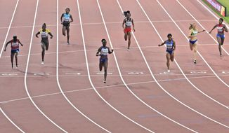 Dina Asher-Smith, of Great Britain, fourth from left, and others from left, Gina Bass, of The Gambia, Lisa Marie Kwayie, of Germany, Anthonique Strachan, of Bahamas, Kamaria Durant, of Trinidad and Tobago, Dezerea Bryant, of the United States, Maja Mihalinec, of Slovenia, and Marileidy Paulino, of the Dominican Republic, compete in the women's 200 meter semifinals at the World Athletics Championships in Doha, Qatar, Tuesday, Oct. 1, 2019. (AP Photo/Martin Meissner)