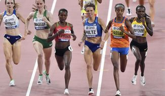 Sarah Mcdonald, of Great Britain, Ciara Mageean, of Ireland, Faith Kipyegon, of Kenya, Nikki Hiltz, of the United States, Sifan Hassan, of the Netherlands, and Winnie Nanyondo, of Uganda, from left, compete in the women's 1500 meter heats at the World Athletics Championships in Doha, Qatar, Wednesday, Oct. 2, 2019. (AP Photo/Martin Meissner)