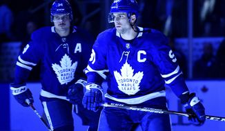 Toronto Maple Leafs centre John Tavares (91) takes to the ice as team captain prior to the first period of an NHL game, against the Ottawa Senators Wednesday, Oct. 2, 2019 in Toronto. Assistant captain Auston Matthews looks on.(Nathan Denette/The Canadian Press via AP)