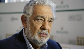 """FILE - In this Aug. 26, 2014, file photo, Spanish tenor Placido Domingo gives details about the opera competition Operalia at the Dorothy Chandler Pavilion in Los Angeles. Opera star Placido Domingo has resigned as general director of the Los Angeles Opera following multiple allegations of sexual harassment reported by The Associated Press. In a statement Wednesday, Oct. 2, 2019, Domingo said the allegations have """"created an atmosphere in which my ability to serve this company that I so love has been compromised."""" He has served as general director since 2003. (AP Photo/Damian Dovarganes, File)"""