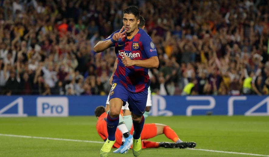 Barcelona's Luis Suarez celebrates after scoring his side's second goal during the group F Champions League soccer match between F.C. Barcelona and Inter Milan at the Camp Nou stadium in Barcelona, Spain, Wednesday, Oct. 2, 2019. (AP Photo/Emilio Morenatti)