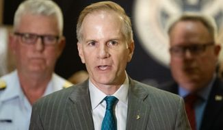 FILE - In this June 21, 2019 file photo, U.S. Attorney for the Eastern District of Pennsylvania William McSwain speaks with members of the media at a news conference at the U.S. Custom House in Philadelphia. A federal judge ruled Wednesday, Oct. 2,  that a Philadelphia nonprofit's proposal to open the nation's first supervised injection site does not violate federal law,the first court decision in the country to definitively weigh in on the matter. (AP Photo/Matt Rourke, File)