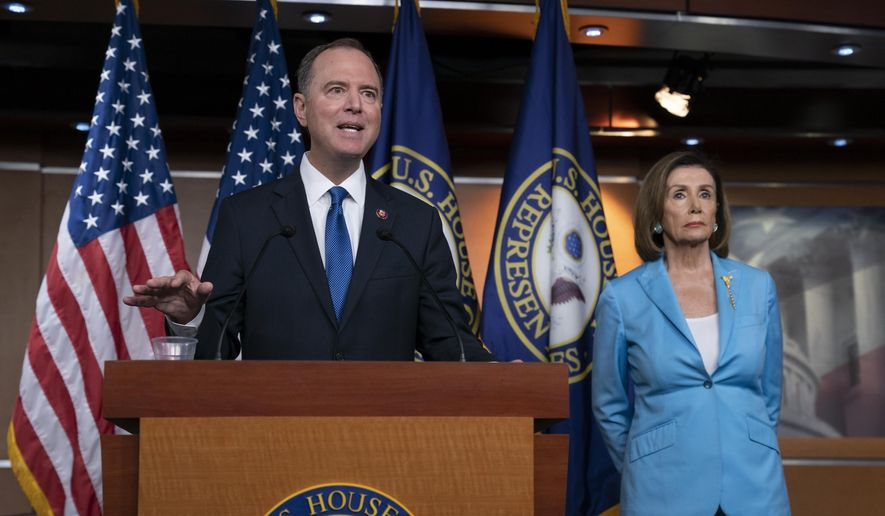 House Intelligence Committee Chairman Adam Schiff, D-Calif., joins Speaker of the House Nancy Pelosi, D-Calif., right, at a news conference as House Democrats move on depositions in the impeachment inquiry of President Donald Trump, at the Capitol in Washington, Wednesday, Oct. 2, 2019. In an unusual show of anger today, Trump defended his phone call with the president of Ukraine and said Adam Schiff may have committed treason by investigating the matter. (AP Photo/J. Scott Applewhite) **FILE**