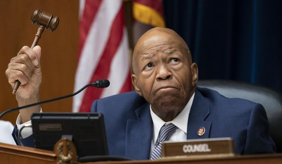 """In this June 12, 2019, file photo, House Oversight and Reform Committee Chairman Elijah E. Cummings, D-Md., wields his gavel on Capitol Hill in Washington, Wednesday, June 12, 2019.  Cummings says in a letter to White House acting chief of staff Mick Mulvaney that he wants all documents """"memorializing communications between President Trump and the leader of any other foreign country"""" that relate to Trump's efforts to pressure the Ukrainian president. (AP Photo/J. Scott Applewhite)"""