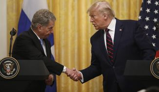 President Donald Trump shakes hands with Finnish President Sauli Niinisto, as they participate in a news conference at the White House in Washington, Wednesday, Oct. 2, 2019. (AP Photo/Carolyn Kaster)