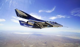 FILE - In this May 29, 2018 photo provided by Virgin Galactic, the VSS Unity craft flies during a supersonic flight test. Virgin Galactic said Wednesday, Oct. 2, 2019 that it has been contracted by the Italian air force for a suborbital research flight aboard its winged rocket ship. (Virgin Galactic via AP, File)