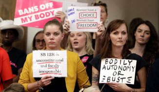 The medical conflict between pro-life and pro-choice doctors erupted this summer after Facebook removed two videos from Live Action about abortion. (ASSOCIATED PRESS PHOTOGRAPHS)