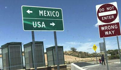 This Tuesday, April 16, 2019, photo shows the Mexico-US border check point area near the U.S. Customs and Border Protection Nogales/Mariposa Port of Entry in Nogales, Ariz. (AP Photo/Patricio Espinoza)