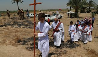 Iraqi Christians attend Mass at the archaeological site of Kokheh Church south of Baghdad, Iraq, Friday, Aug 23, 2019. The historical church located on the left bank of the Tigris River some 20 miles south of the capital Baghdad dates back to the first century AD. Remnants of the church, an archaeological site and one of the most important sites of Eastern Christianity, was reopened again to the public last year after a years-long closure due to security concerns. (AP Photo/Khalid Mohammed)