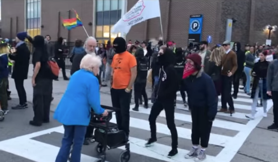 An elderly woman is blocked crossing the street by a handful of antifa protestors. (screenshot: Youtube/TheSpec)