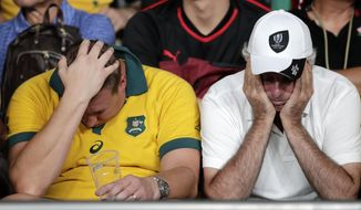 Australian supporters react following the Rugby World Cup Pool D game at Tokyo Stadium between Australia and Wales in Tokyo, Japan, Sunday, Sept. 29, 2019. Wales defeated Australia 29-25. (AP Photo/Jae Hong)