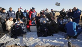 U.S. astronaut Nick Hague, right, Russian cosmonaut Alexey Ovchinin, centre, and United Arab Emirates astronaut Hazzaa Ali Almansoori, sit in chairs shortly after the landing of the Russian Soyuz MS-12 space capsule about 150 km ( 90 miles) south-east of the Kazakh town of Zhezkazgan Kazakhstan, Thursday, Oct. 3, 2019. A Soyuz space capsule with U.S. astronaut Nick Hague, Russian cosmonaut Alexey Ovchinin and United Arab Emirates astronaut Hazzaa Ali Almansoori, returning from a mission to the International Space Station landed safely on Thursday on the steppes of Kazakhstan. (AP Photo/Dmitri Lovetsky, Pool)