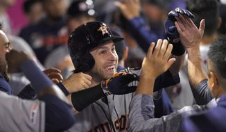 Houston Astros' Josh Reddick is congratulated by teammates in the dugout after hitting a three-run home run during the sixth inning of a baseball game against the Los Angeles Angels Saturday, Sept. 28, 2019, in Anaheim, Calif. (AP Photo/Mark J. Terrill)