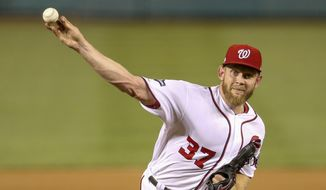 Washington Nationals starting pitcher Stephen Strasburg (37) pitches during the sixth inning of a National League wild card baseball game against the Milwaukee Brewers at Nationals Park, Tuesday, Oct. 1, 2019, in Washington. (AP Photo/Andrew Harnik) **FiLE**