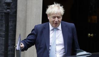 "Britain's Prime Minister Boris Johnson leaves Downing Street to attend Parliament in London, Thursday, Oct. 3, 2019. The U.K. offered the European Union a proposed last-minute Brexit deal on Wednesday that it said represents a realistic compromise for both sides, as British Prime Minister Boris Johnson urged the bloc to hold ""rapid negotiations towards a solution"" after years of wrangling. (AP Photo/Kirsty Wigglesworth)"