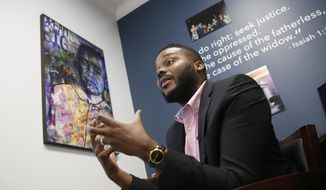 FILE -- In this Wednesday Aug. 14, 2019 file photo Stockton Mayor Michael Tubbs discusses a program he initiated to give $500 to 125 people who earn at or below the city's median household income of $46,033 during an interview in Stockton, Calif. After eight months new data shows people have spent 70 percent of that money on things like food, clothing and utility bills. Tubbs hopes the new data will win over skeptics. (AP Photo/Rich Pedroncelli, File)