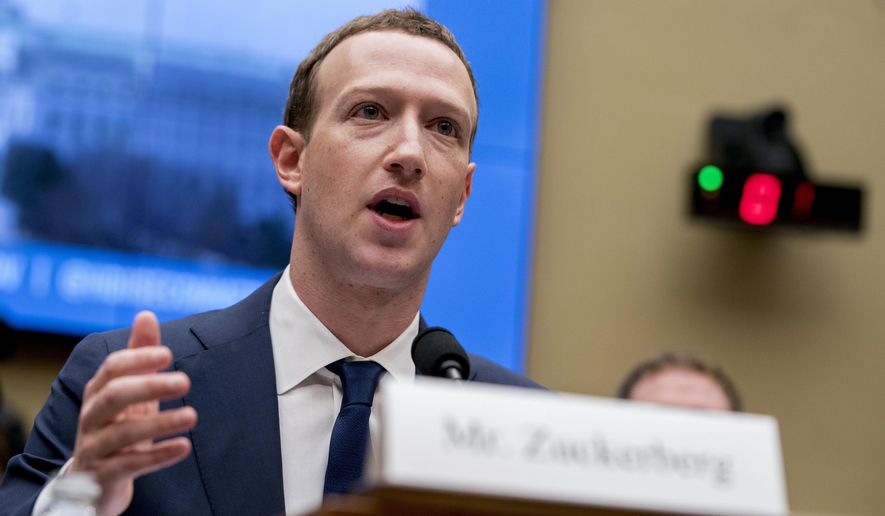 FILE - In this April 11, 2018, file photo, Facebook CEO Mark Zuckerberg testifies before a House Energy and Commerce hearing on Capitol Hill in Washington about the use of Facebook data to target American voters in the 2016 election and data privacy. Attorney General William Barr wants Facebook to give law enforcement a way to read encrypted messages sent by users, re-igniting tensions between tech companies and law enforcement.  (AP Photo/Andrew Harnik, File)