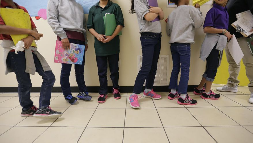 "Migrant teens line up for a class at a ""tender-age"" facility for babies, children and teens, in Texas' Rio Grande Valley, Thursday, Aug. 29, 2019, in San Benito, Texas. The facility offers services that include education, nutrition, hygiene, recreation, entertainment, medical, mental health and counseling, according to a U.S. Health and Human Services official. (AP Photo/Eric Gay)"