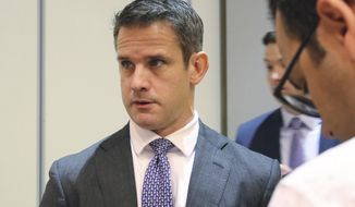 "Rep. Adam Kinzinger R-Ill., speaks to reporters after attending an event Thursday, Oct. 3, 2019, in Chicago. They don't like the talk of impeachment, but there's a small and growing number of Republicans who want the Democratic-run House investigation of President Donald Trump to proceed. 'I want to know what happened,"" Rep. Adam Kinzinger, said Thursday. But he and some others, including moderates in tight reelection races, say Democrats went too far by starting an impeachment inquiry. (AP Photo/Noreen Nasir)"
