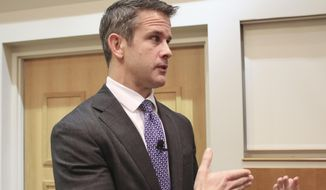 Rep. Adam Kinzinger R-Ill., speaks to reporters after attending an event Thursday, Oct. 3, 2019, in Chicago.  (AP Photo/Noreen Nasir) **FILE**