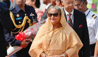 Bangladesh Prime Minister Sheikh Hasina arrives at the airport in New Delhi, India, Thursday, Oct.3, 2019. Hasina is on a three-day visit to India. (AP Photo/Manish Swarup)