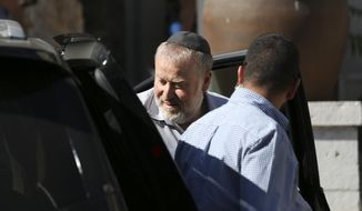 Israel's attorney general Avichai Mandelblit arrives at the Ministry of Justice in Jerusalem for the second day of pre-indictment hearing in the corruption case of Israel's Prime Minister Benjamin Netanyahu, Thursday, Oct. 3, 2019. (AP Photo/Oded Balilty)