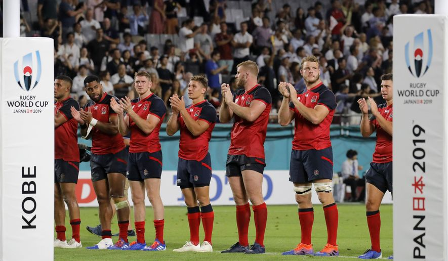 England players line up as they celebrate after the Rugby World Cup Pool C game at Kobe Misaki Stadium against the United States in Kobe, Japan, Thursday, Sept. 26, 2019. England won 45-7. (AP Photo/Christophe Ena)