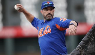 New York Mets manager Mickey Callaway throws batting practice before the team's baseball game against the Colorado Rockies on Tuesday, Sept. 17, 2019, in Denver. (AP Photo/David Zalubowski) ** FILE **
