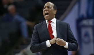 FILE - In this March 13, 2019, file photo, North Carolina State head coach Kevin Keatts directs his team against Clemson during the first half of an NCAA college basketball game in the Atlantic Coast Conference tournament in Charlotte, N.C. Keatts is dealing with offcourt concerns entering his third season. There's the indefinite suspension of a key player, as well as NCAA charges against the program from before his arrival amid the federal corruption investigation into college basketball. (AP Photo/Nell Redmond, File)
