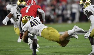 Notre Dame linebacker Drew White (40) tackles Georgia running back D'Andre Swift (7) during the first half of an NCAA college football game, Saturday, Sept. 21, 2019, in Athens, Ga. (AP Photo/Mike Stewart)