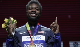 Noah Lyles of the United States, gold medalist in the men's 200 meters, poses during the medal ceremony at the World Athletics Championships in Doha, Qatar, Wednesday, Oct. 2, 2019. (AP Photo/Nariman El-Mofty)