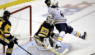 Buffalo Sabres' Zemgus Girgensons (28) collides with Pittsburgh Penguins goaltender Matt Murray (30) during the first period of an NHL hockey game in Pittsburgh, Thursday, Oct. 3, 2019. (AP Photo/Gene J. Puskar)