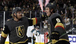 Vegas Golden Knights defenseman Jon Merrill, left, congratulates center Cody Glass after he scored against the San Jose Sharks during the second period of an NHL hockey game Wednesday, Oct. 2, 2019, in Las Vegas. (AP Photo/Isaac Brekken)