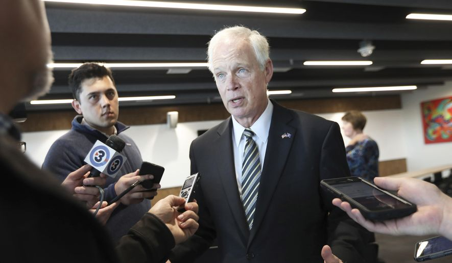 In this file photo, U.S. Sen. Ron Johnson, R-Wis., speaks with members of the media in Madison, Wis., Thursday, Oct. 3, 2019.  (Amber Arnold/Wisconsin State Journal via AP)  **FILE**