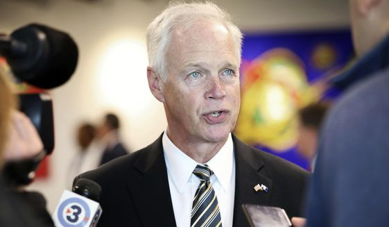 Sen. Ron Johnson, R-Wis., speaks with members of the media before meeting with the Middleton Chamber of Commerce at Serendipity Labs in Madison, Wis., Thursday, Oct. 3, 2019. (Amber Arnold/Wisconsin State Journal via AP) **FILE**