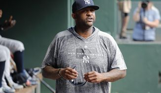 New York Yankees starting pitcher CC Sabathia walks through the dugout in the second inning of a baseball game against the Texas Rangers in Arlington, Texas, Sunday, Sept. 29, 2019. (AP Photo/Tony Gutierrez)